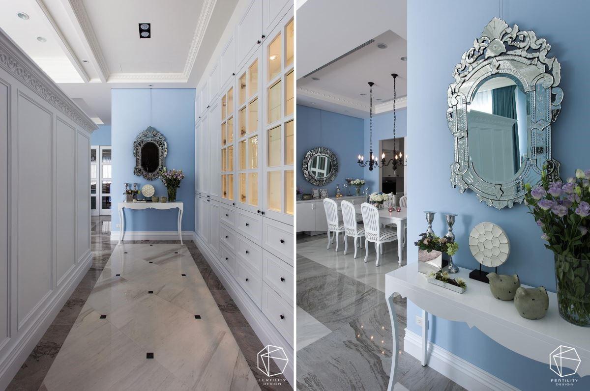 玄关廊道与客厅共享同一道半高墙,循着入口动线,即可见廊道尽头的细腻的端景。