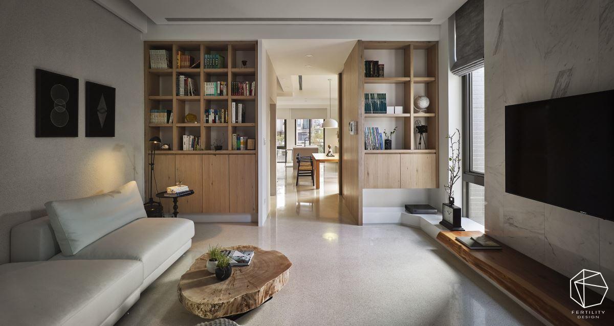 安排简约的沙发与木柜,搭配线条简单的大理石电视墙,构成单纯却不失气度的使用场景。