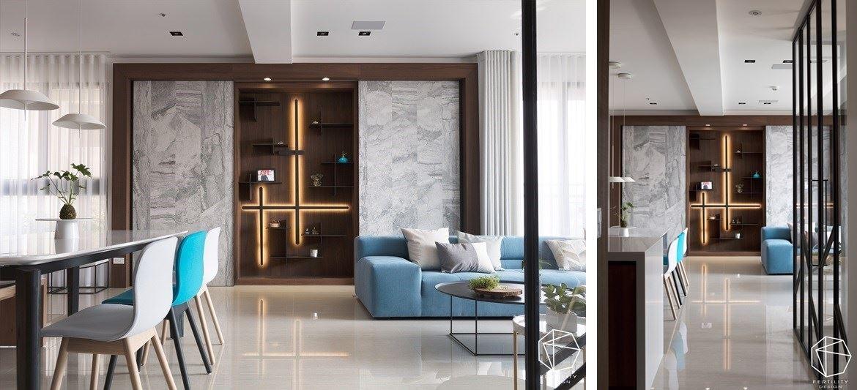 有别于其他制式空间,将视觉重心放在沙发背墙上的展示柜,顺着原进筑物结构 将储藏室跟展示柜加以结合,形成一幅走道看过来的端景画面,藉由木皮与铁件搭接书架,结合灯光及展示品妆点 变成独一无二的空间焦点。